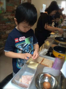 My little chef at work. I was really proud of him because at home he is often overshadowed by the others.