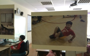 A photo of the boy at one of the PE lessons, pasted onto the classroom window.