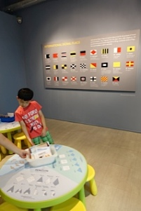 The flags are interesting, but...did they just take this wholesale from the Singapore Maritime Gallery?